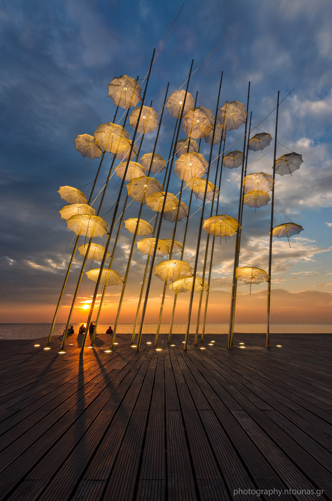 Under the Umbrellas by Alexios Ntounas