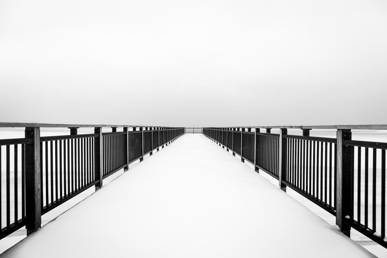 Snow Filled Pier by Michael B. Stuart