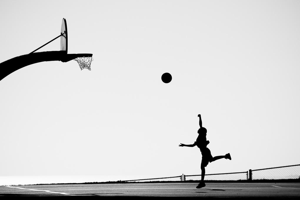 Boy Playing Basketball by Manuela Durson