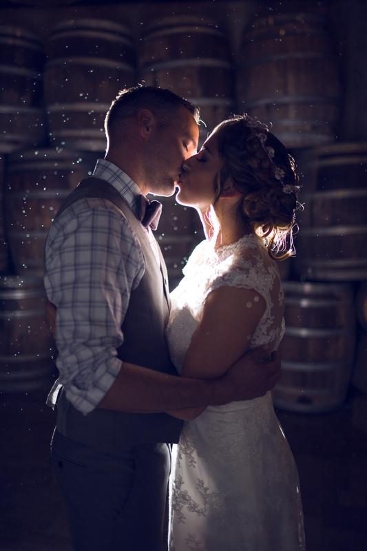 Rainy wedding night kiss by Casey Wrightsman