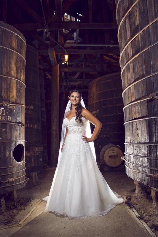 Bride barrel room portrait by Casey Wrightsman