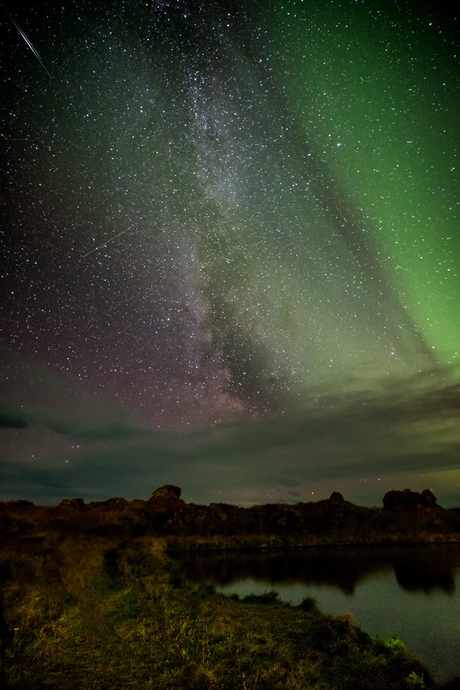 Milky way behind the aurora by Andrea Re Depaolini