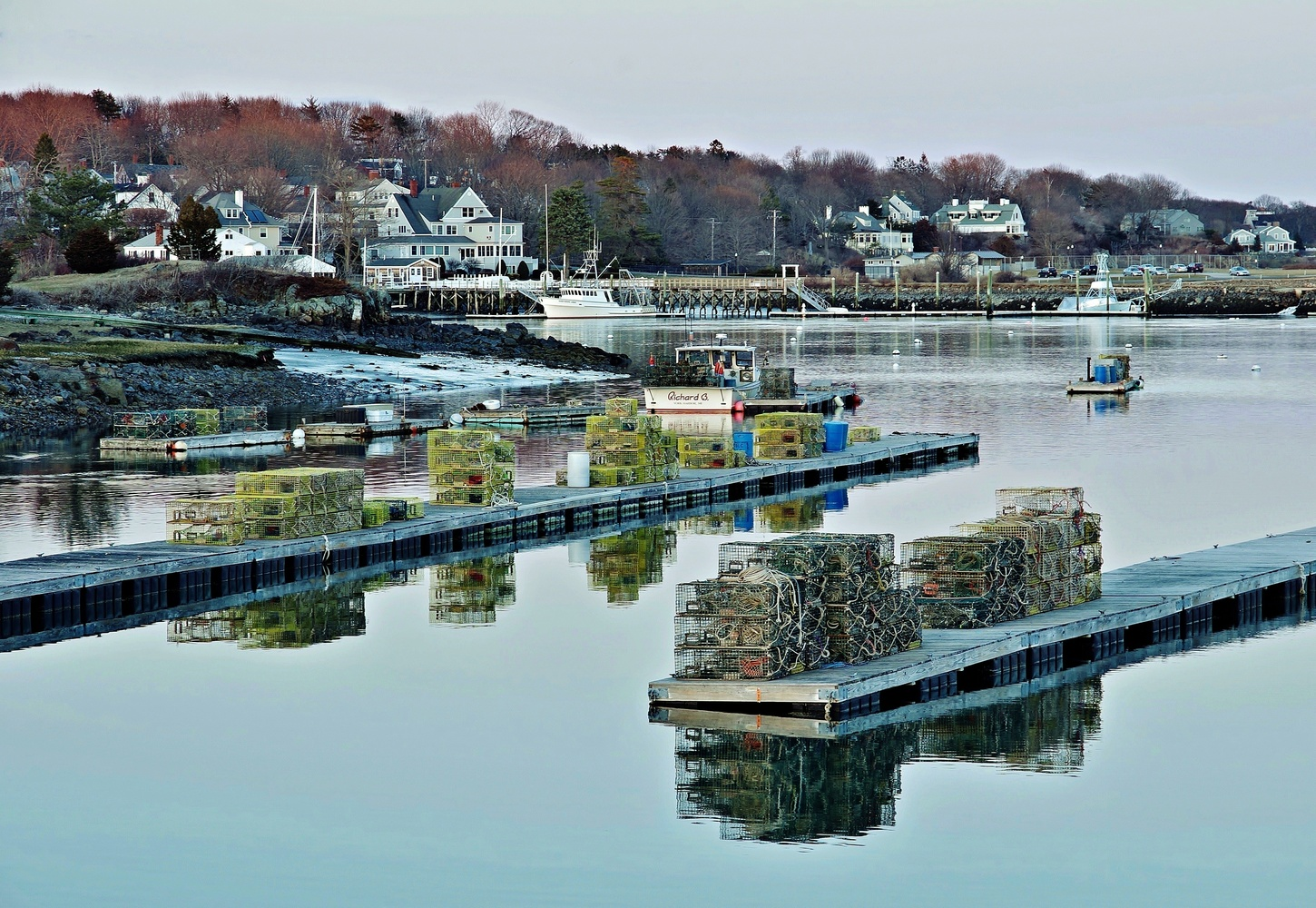 Harbor reflections by James Mlodynia