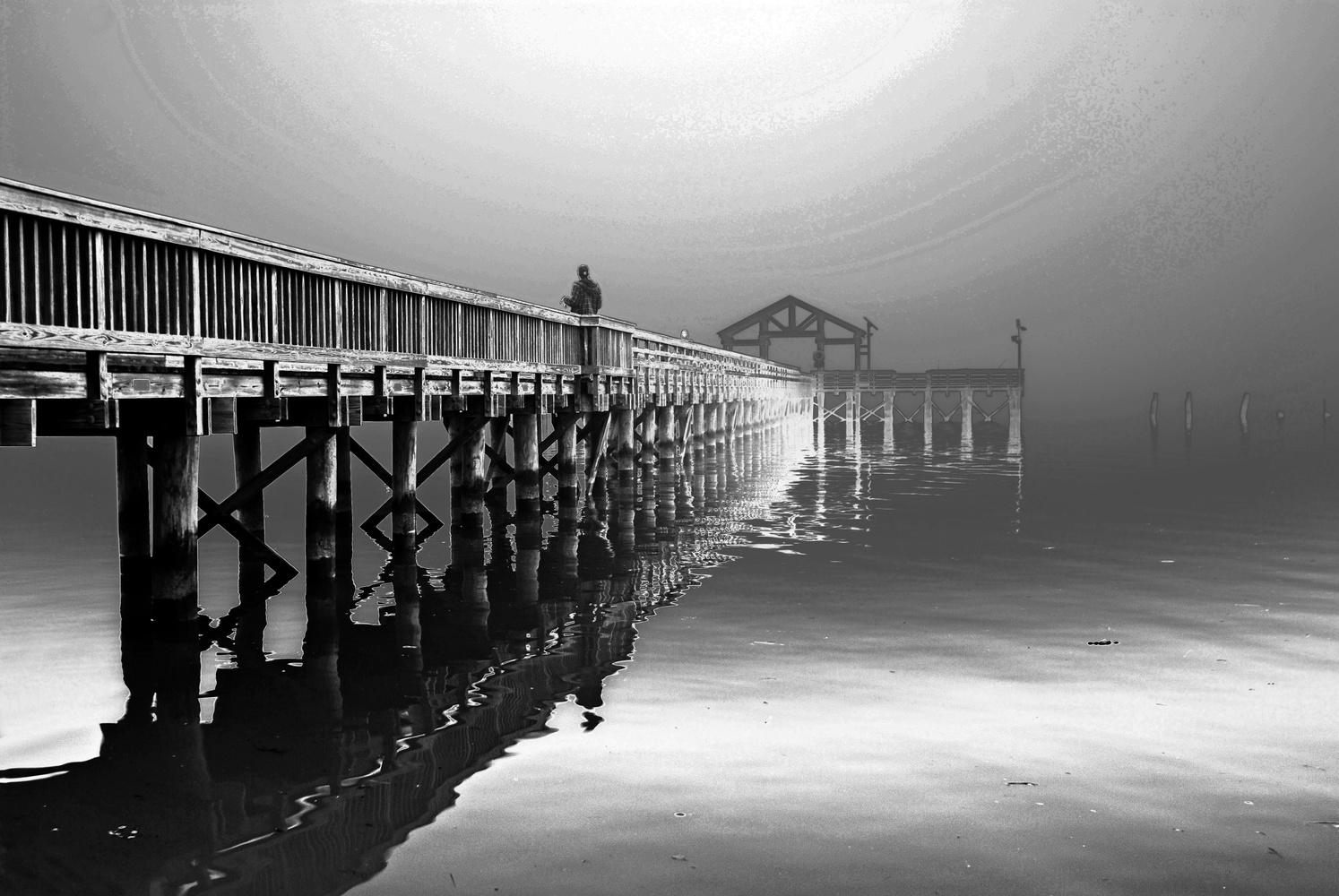 Fishing pier in fog by Bill Jonscher
