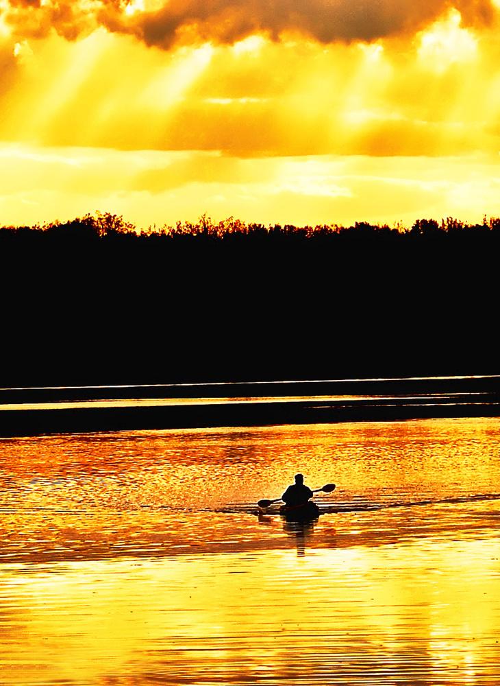 Kayaker on the Potomac River at sunset by Bill Jonscher