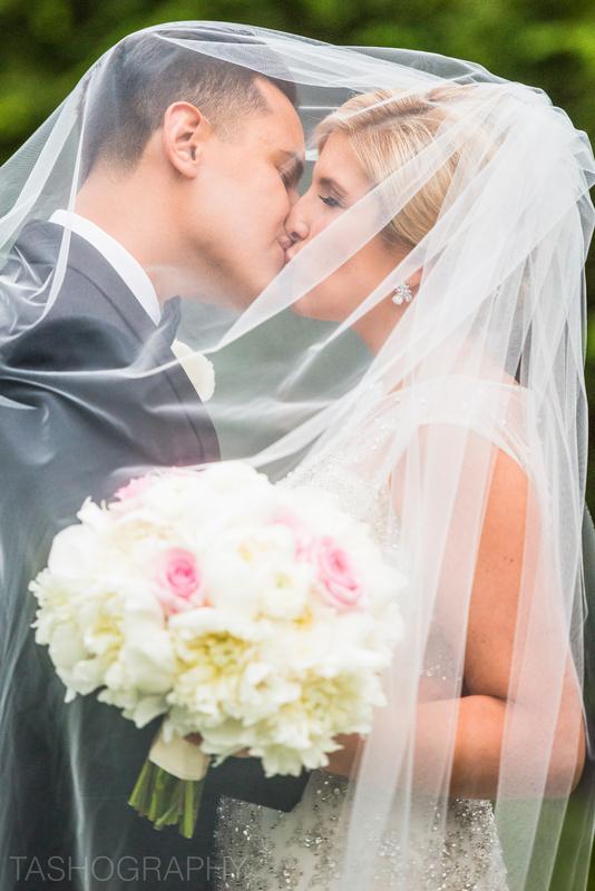 Bride & Groom Under the Veil by Natasha Miller