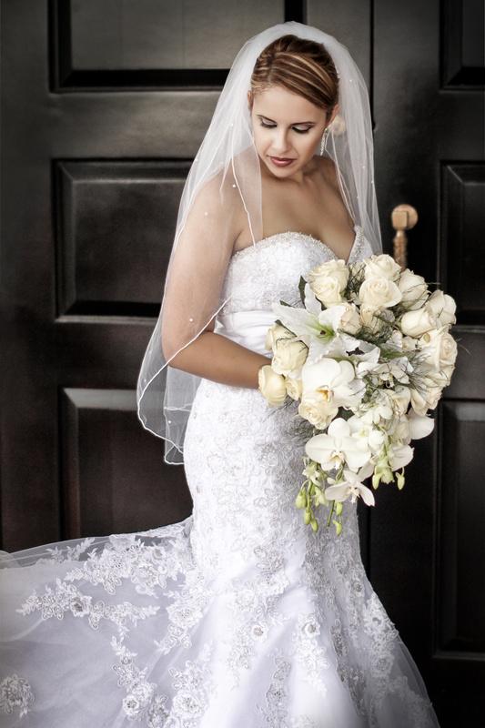 Bride at door by Josue Martinez
