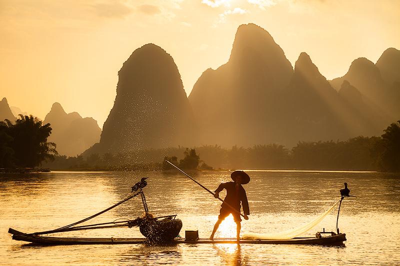 Cormorant Fisherman on the Li by Ken Koskela