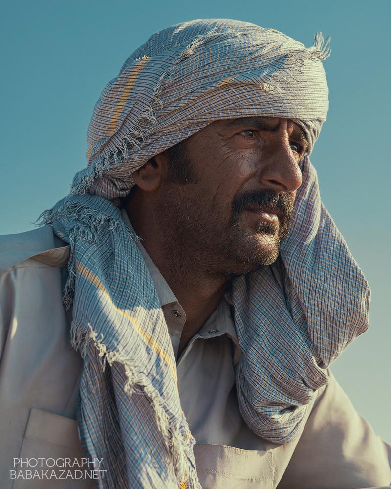 Baloochi man Darak Beach by Bob Libero