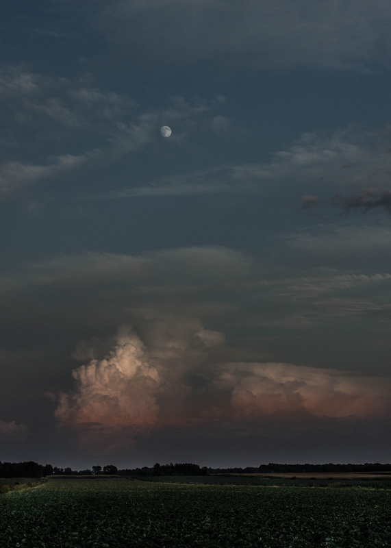 Moonrise and sunset with clouds by Patrice Brien