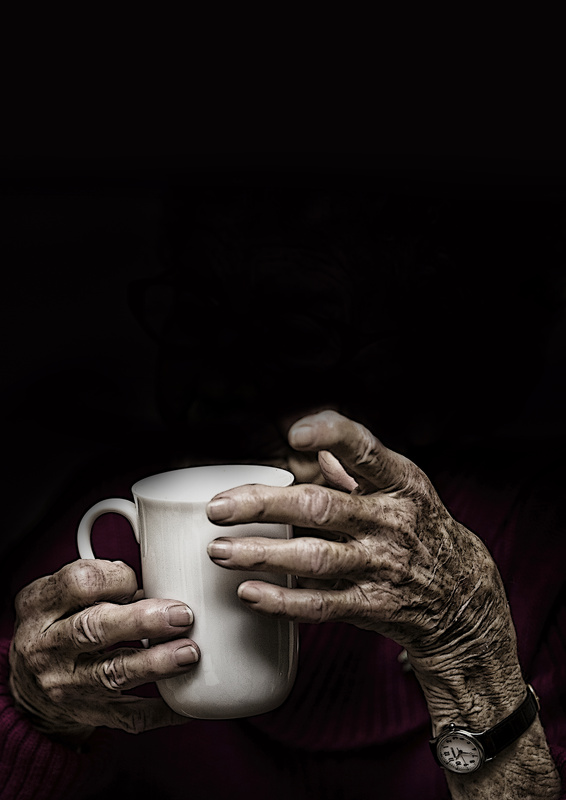 Aged hands holding a cup. by Sheila Smart