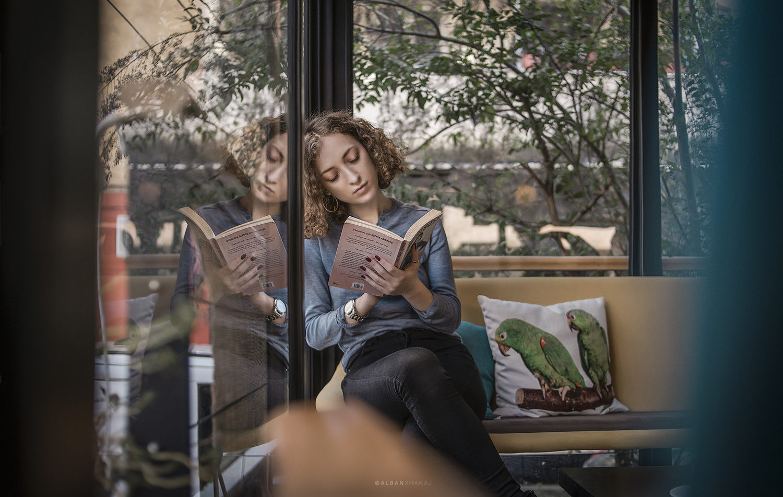 reading next to the window by Alban Xhakaj
