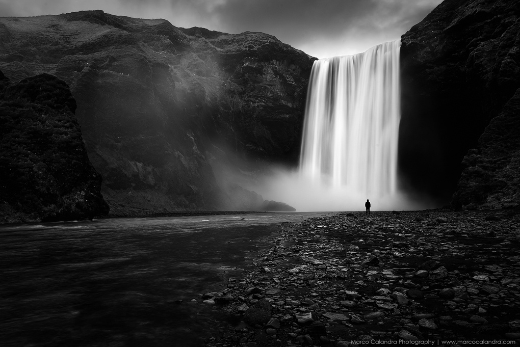 Alone in Skogafoss by Marco Calandra