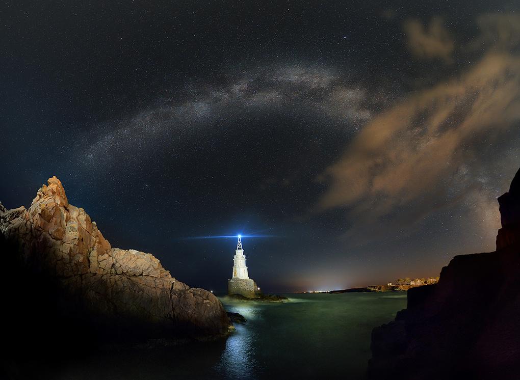 Rainbow of stars over lighthouse by Krasi St M