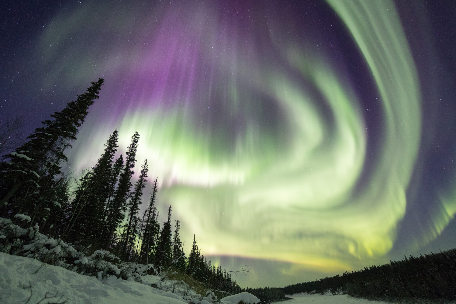 Winter's aurora over the Hay River by Adam Hill