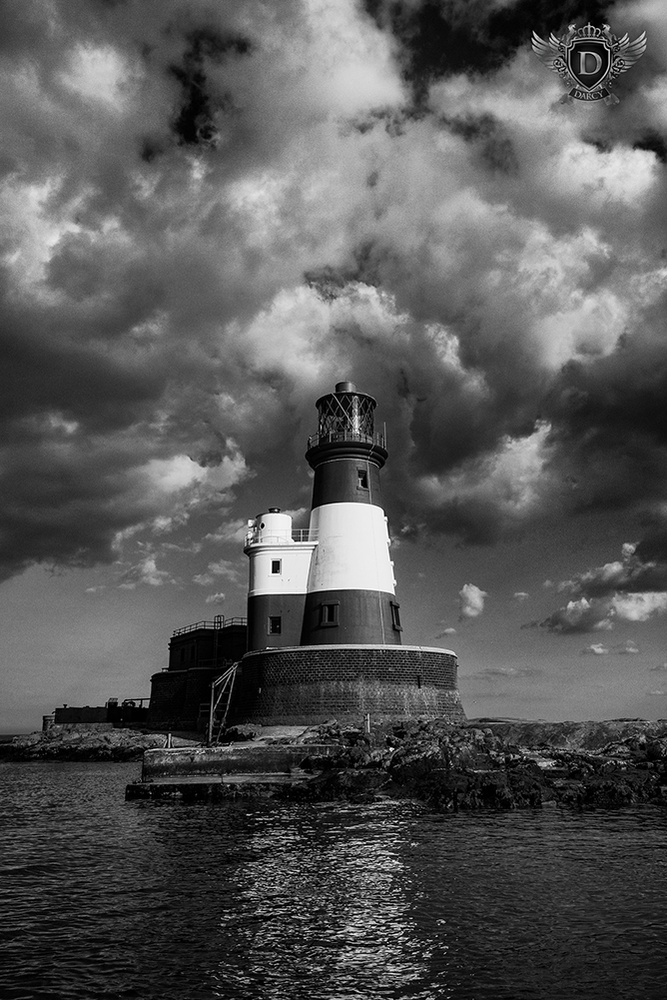 Light over Longstone by Darcy Brown