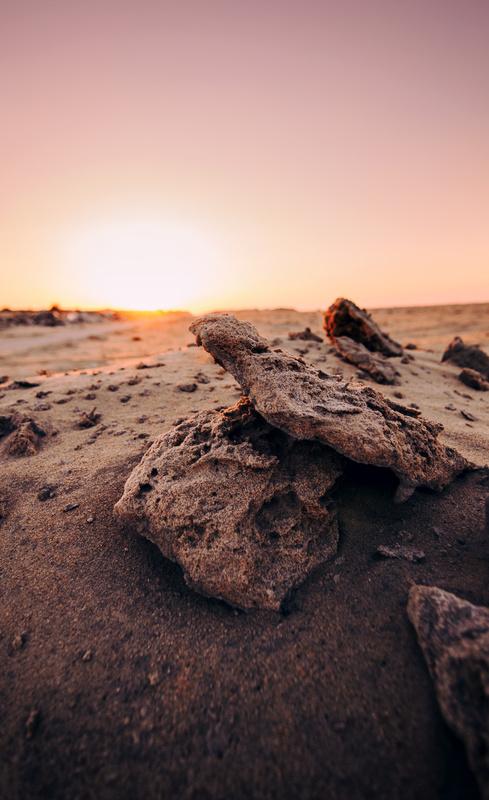 rocks in the sunset by NASSER ALKHALDI