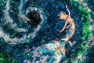 Photographer Captures 10,000 Plastic Bottles And A Mermaid To Send The World A Message