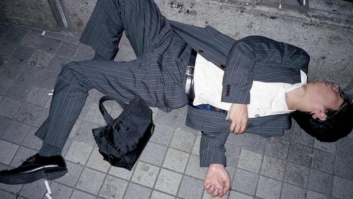 Photo Series of Businessmen Sleeping in the Street Spotlights Tokyo's Disturbing Overworking Culture