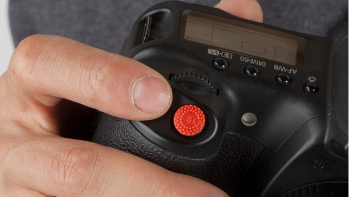 "Enjoy A No-Slip Finger Grip With Shutter Button Sticker Called ""ProDot"""