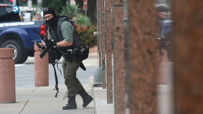 Photographer Captures Gunman Staring Right in to His Lens at Dallas Shooting