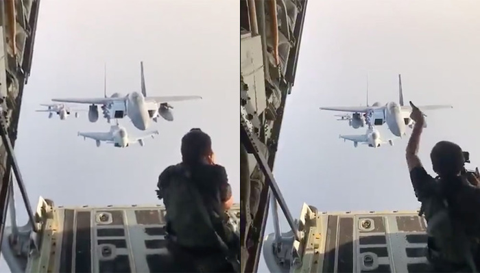 Daredevil Photographer Sits on Cargo Door to Take Pictures of Jets Flying Directly Behind Him