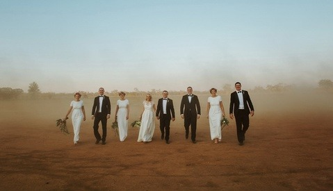 Viral Wedding Photo Raises Nearly $15,000 for Charity in 24 Hours