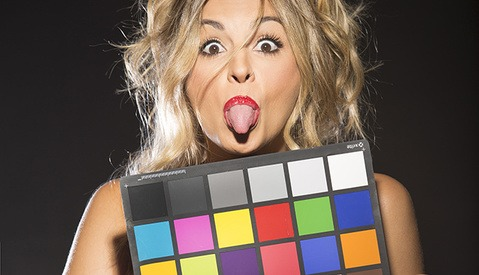 Model making funny face with color chart