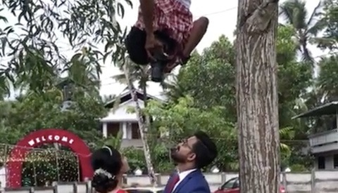 This Wedding Photographer Will Do Anything to Get the Shot