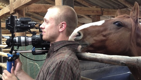 This Cameraman Does a Great Job of Keeping It Together Despite Way Too Much Horsing Around