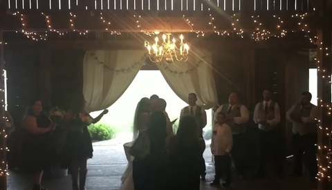 Wedding Photographer Shoves Stepmom With Phone out of the Way to Shoot First Kiss