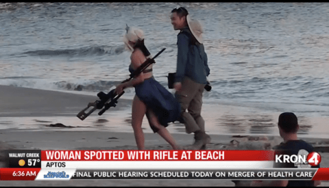 Photographer and Model Spotted Using Huge Fake Rifle in Public Beach Photoshoot