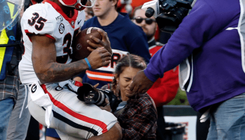 Kneeling Photographer Knocked Unconscious After Sideline Collision at Football Game