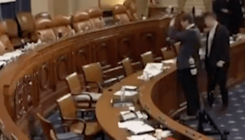 Reuters' Photojournalist Caught Taking Pictures of Documents at Trump's Impeachment Hearing