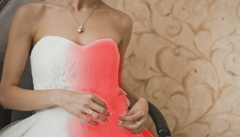 Wedding Photographer Forced to Photoshop Mother-In-Law's Dress Red After She Defied Bride and Wore White