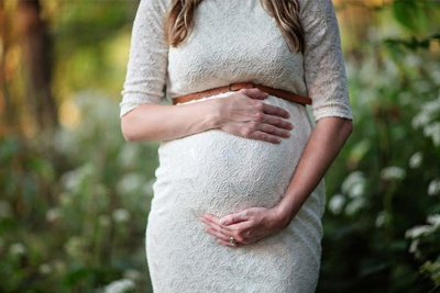 Client Fires Photographer From Maternity Shoot After Learning She's a Lesbian