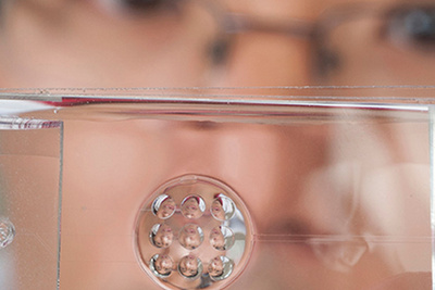 Fluid-Filled Lens Mimics Best Traits of Human Vision