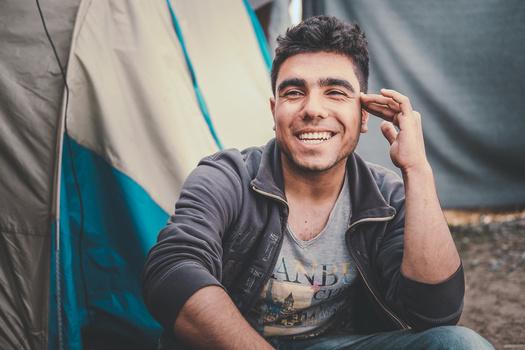 man refugee smiling