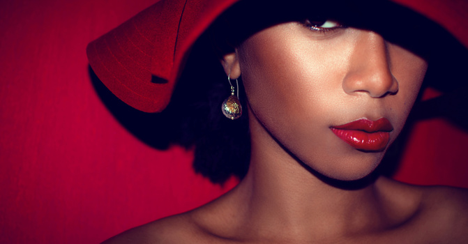 woman hat red earring