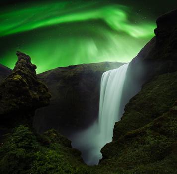 composite of skogafoss and aurora