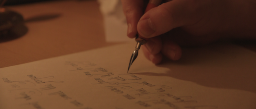 Sliding the camera with the left hand while writing with the right hand
