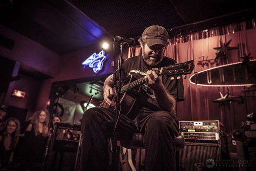 a photo of Scott H Biram playing live