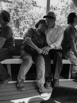 Street photograph of an elderly couple embracing