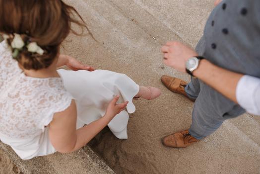 A bride and groom on the beach