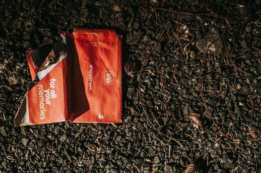 A red package discarded on the street