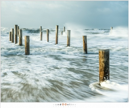 The North Sea during a South-West storm. I wanted to catch the strength of the waves hitting the poles and beach. For that I used a 3 stop ND to extend the exposure time enough to capture details in the water (EOS 1Dx + EF24-70L @ 57mm | ISO50 | f/11 | 1/