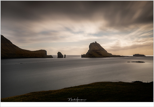 The island Tindhólmur at the Faroër Islands, A longer exposure made the movement of the water and clouds smooth, yet visible. (EOS 5D mark IV + EF24-70L @ 35mm | ISO100 | f/8 | 90sec with Lee Big Stopper)