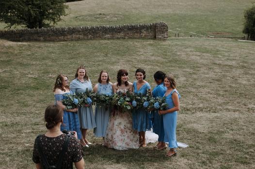 A group shot of bridesmaids and bride.