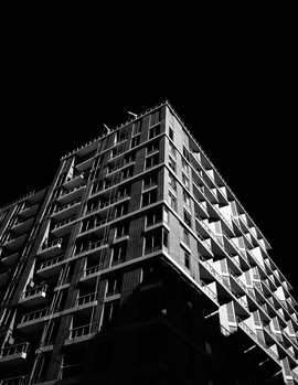 black and white building with a dark sky