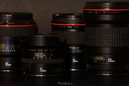 This set of four primes cover a good range of focal lengths, roughly similar to the two zoom lenses from the previous photo. But you need to carry four lenses instead of two, lens changes will be very frequent, and you miss a lot of focal lengths if you c